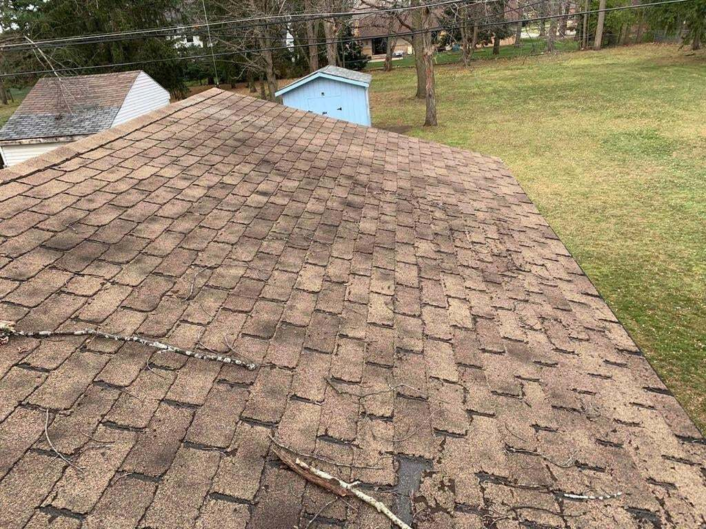 Top view of a roof with wear and tear